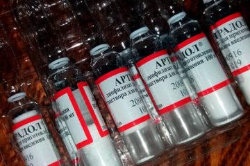 открытая упаковка с ампулами артрадола